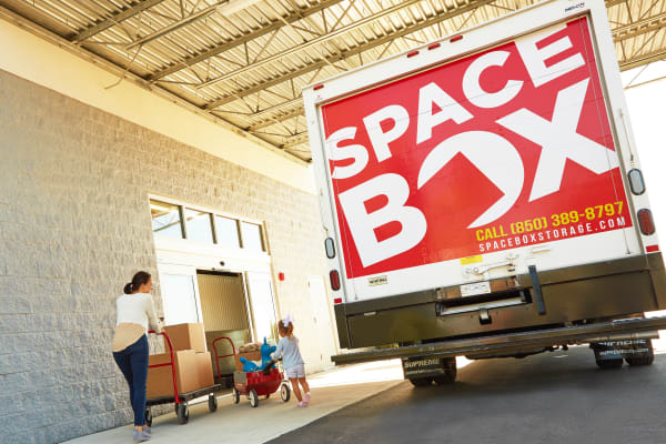 A family moving using the free moving truck at Spacebox Storage Fort Myers in Fort Myers, Florida.