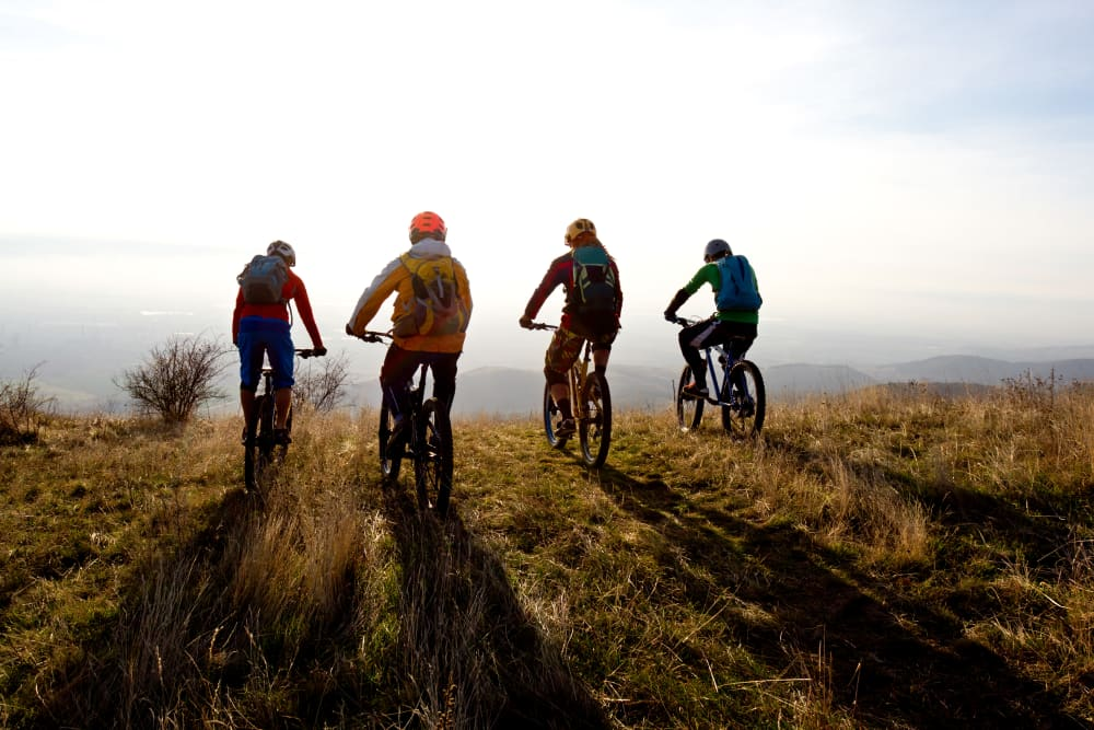 Mountain bikers overlooking the Columbia River Gorge, near Trojan Storage