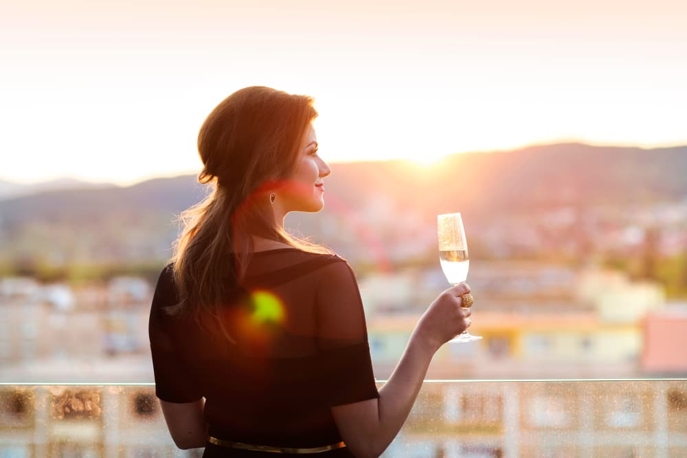 Resident enjoying the view from her private balcony at The Reserve at Gilbert Towne Centre in Gilbert, Arizona