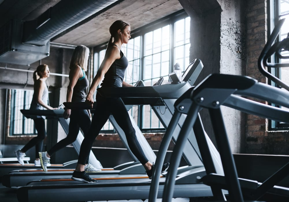 Residents staying in shape in the fitness center at TwentyTwenty Apartments in Portland, Oregon