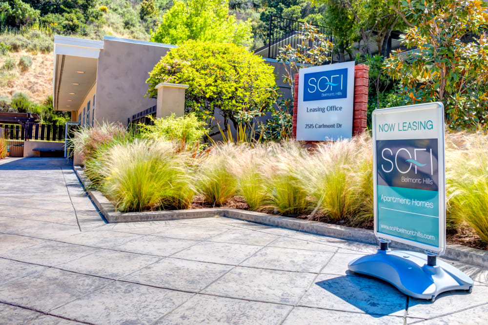 Exterior of the leasing center with well-maintained landscaping at Sofi Belmont Hills in Belmont, California