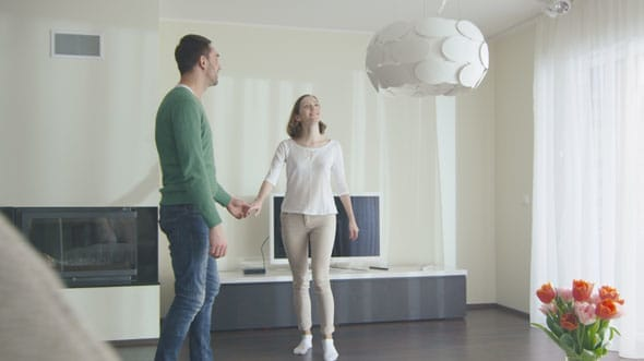 16_70_15_Happy_Couple_Walking_into_New_home_and_Looking_Around