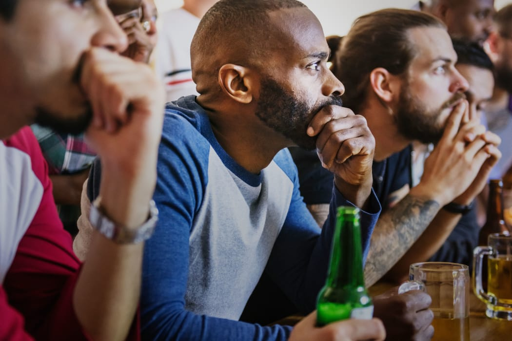 Friends enjoying beverages at Tuscana Bay Apartments in Corpus Christi, Texas