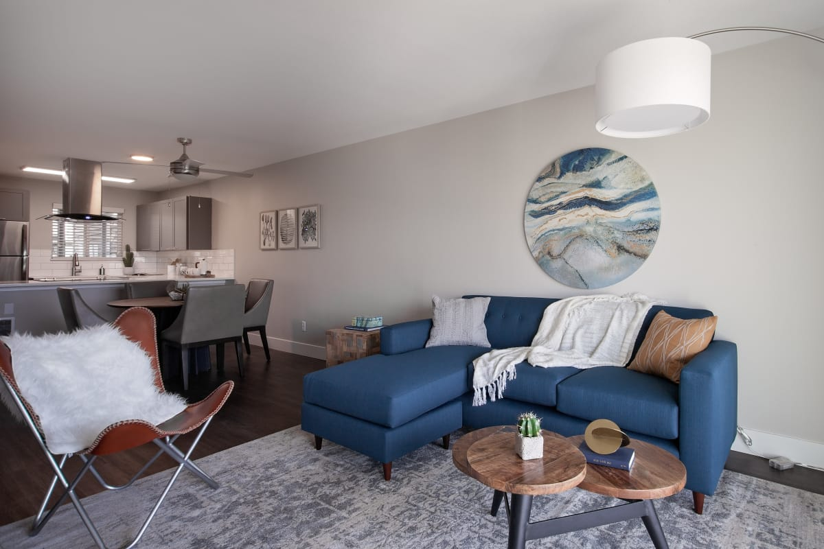 Bright and well-decorated living area in model apartment home at MiLO at Mountain Park