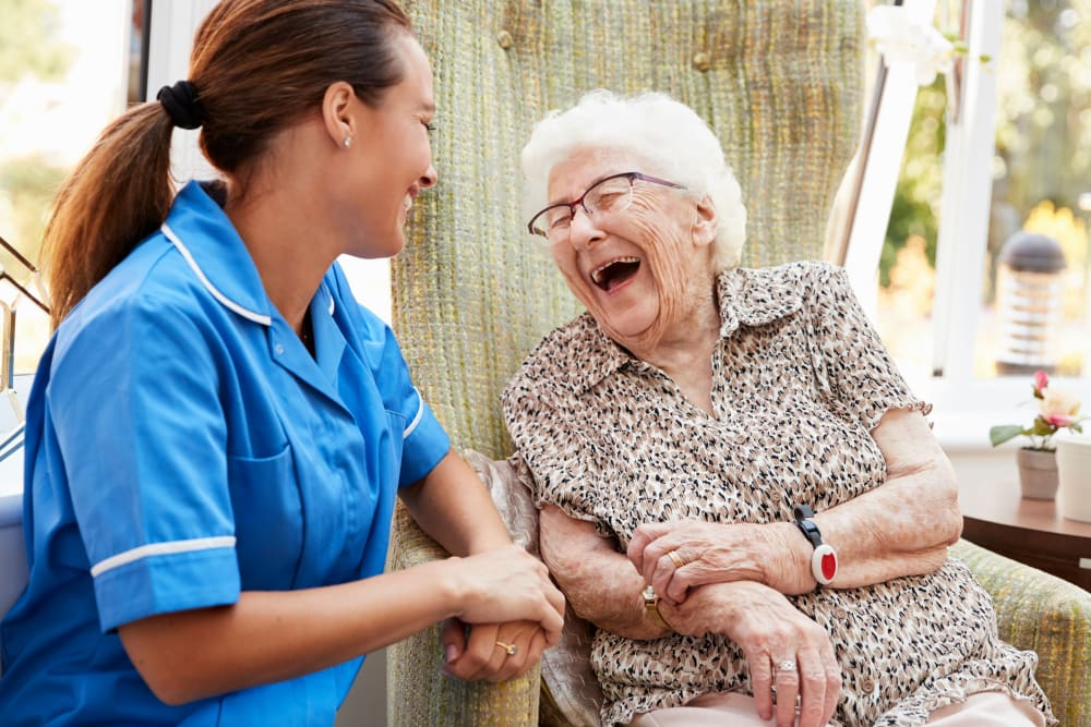 Resident and a nurse sitting outside talking at Serenity in East Peoria, Illinois