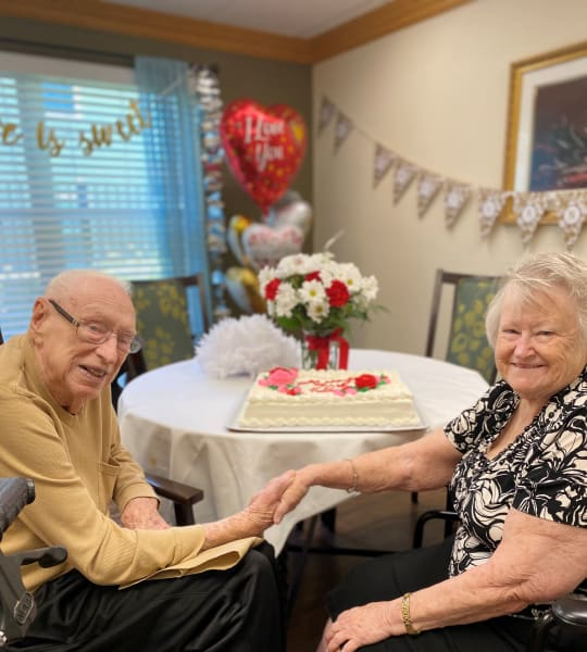 Team members set up decorations and made a tasty cake for Bertha and John's 70th anniversary!