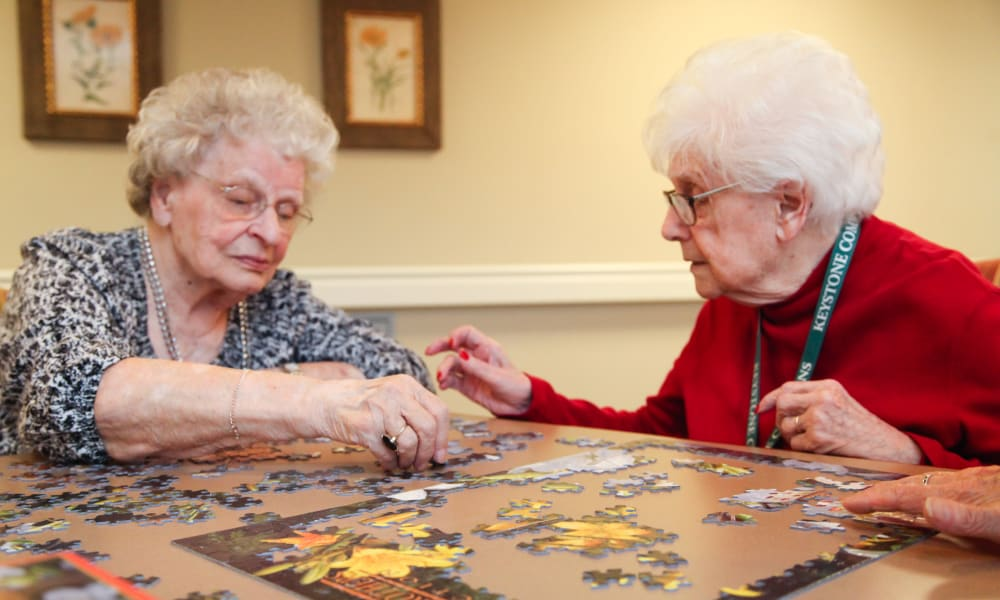 Residents putting together a puzzle at Keystone Commons in Ludlow, Massachusetts