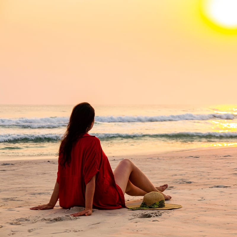 Resident enjoying the sunset on the beach at Portside Ventura Harbor in Ventura, California