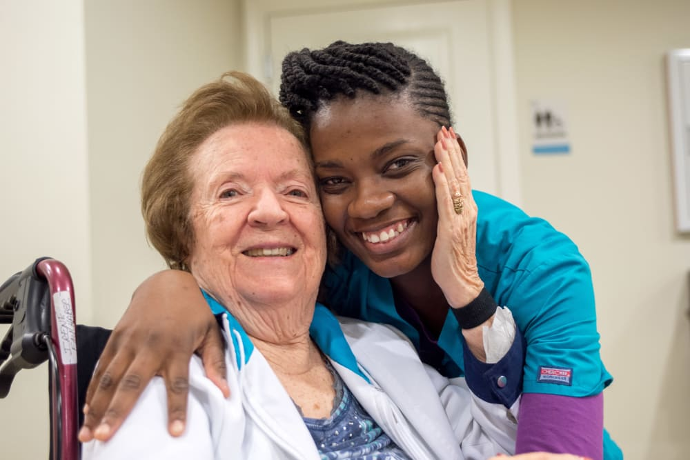 Staff member and resident at Inspired Living Lewisville in Lewisville, Texas