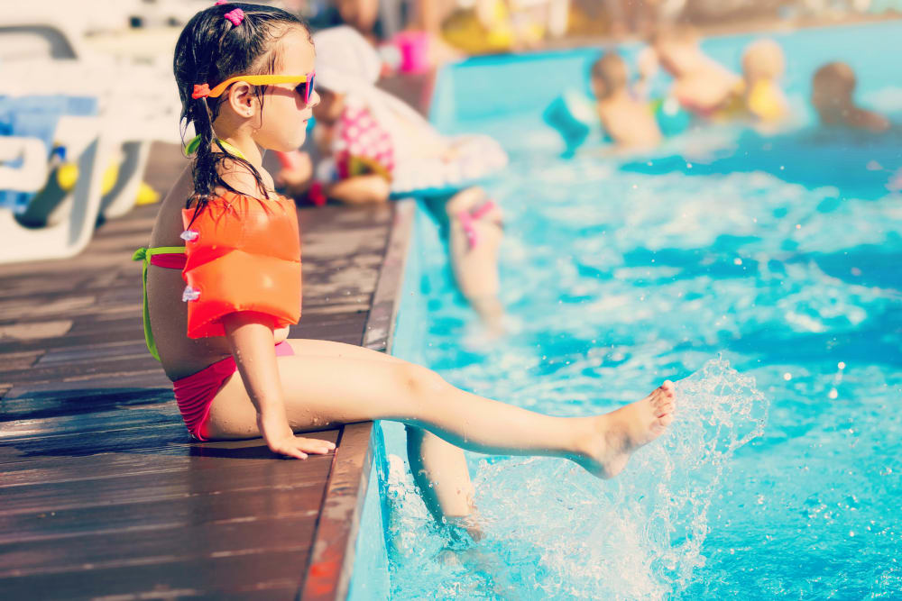 Resident child dipping her feet in the pool at Canyon View in Las Vegas, Nevada