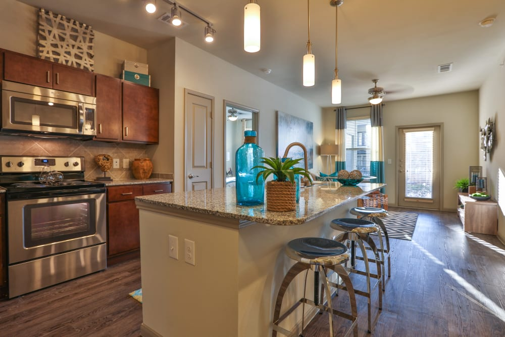 Gourmet kitchen with quartz countertops in a model home at Olympus at Waterside Estates in Richmond, Texas
