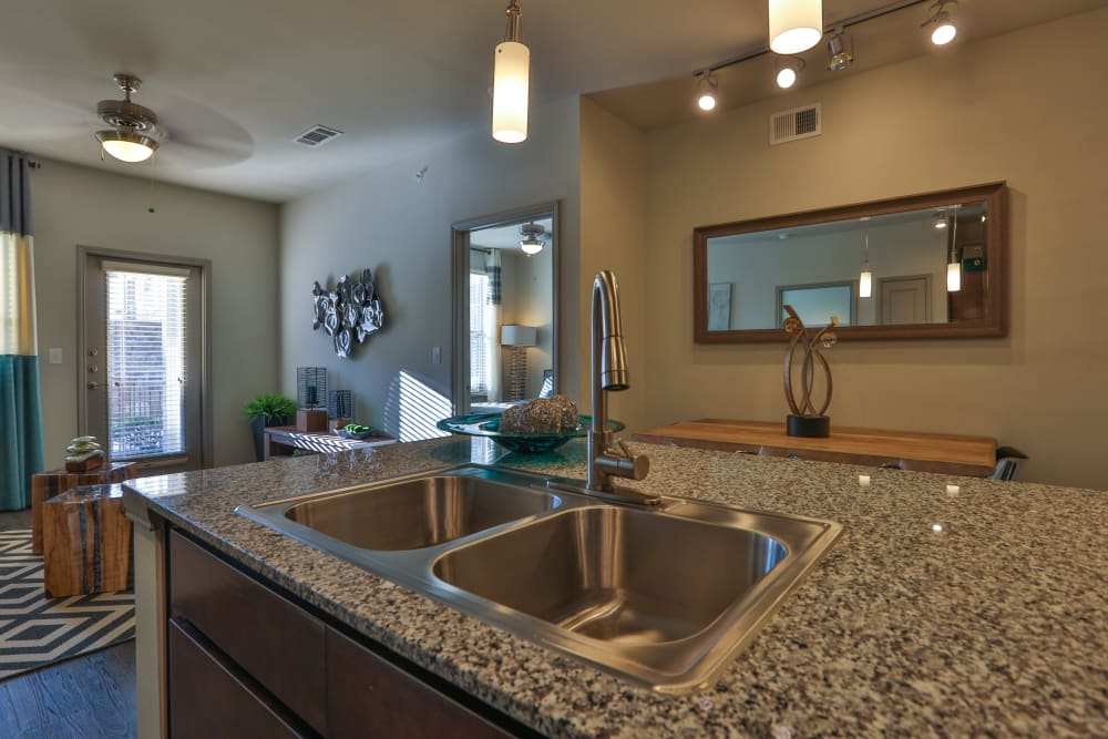 Recessed lighting in kitchen and dining room at Olympus at Waterside Estates in Richmond, Texas