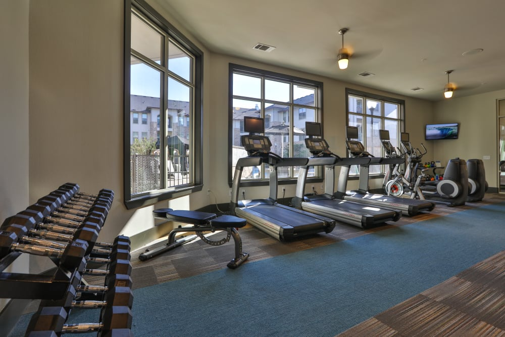 Treadmills in fitness center at Olympus at Waterside Estates in Richmond, Texas