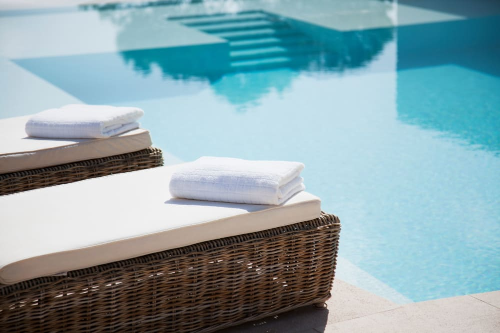 Neatly folded towels by the pool at Magnolia on the Green in Allen, Texas