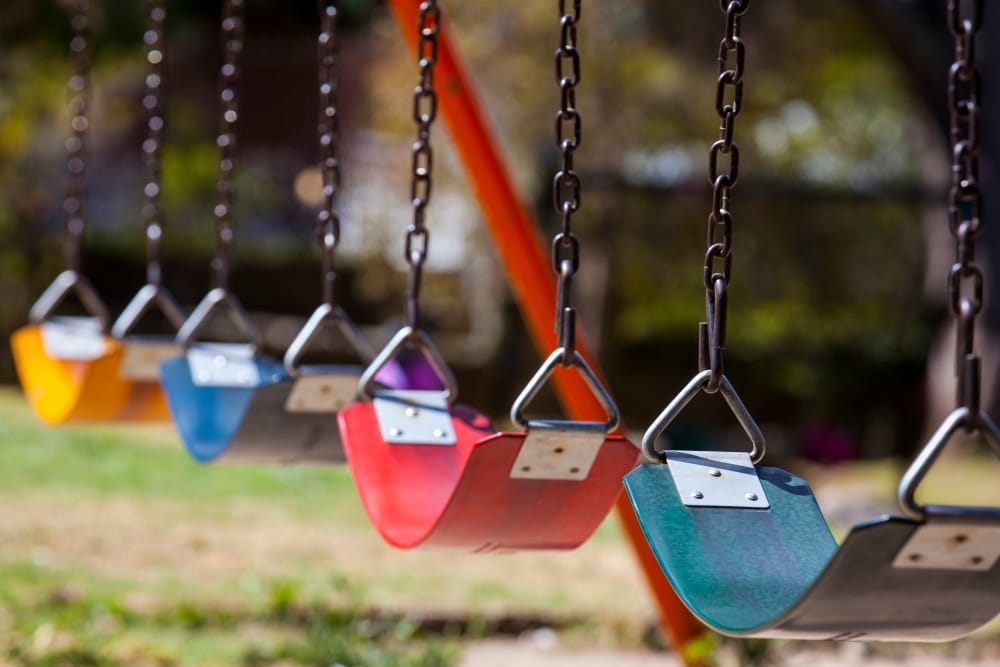 Swing set at the playground near E Street Apartments in Sacramento, California