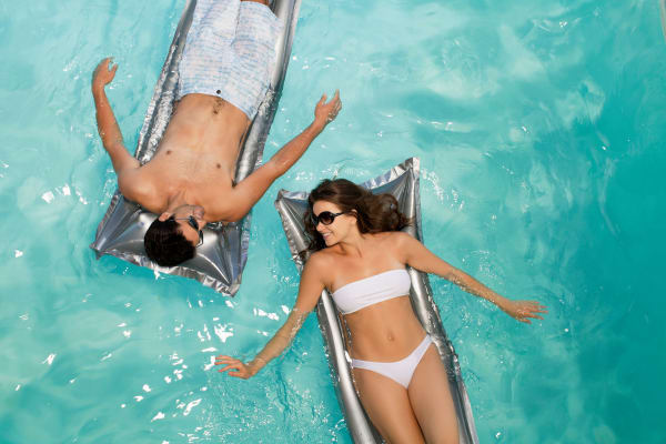 Young couple relaxing in the pool at Broadstone Heights in Albuquerque, New Mexico