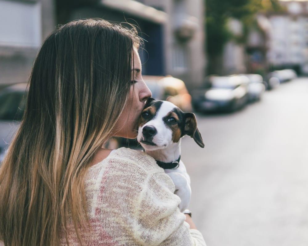 Resident kissing her dog at Villas at Carlsbad in Carlsbad, California
