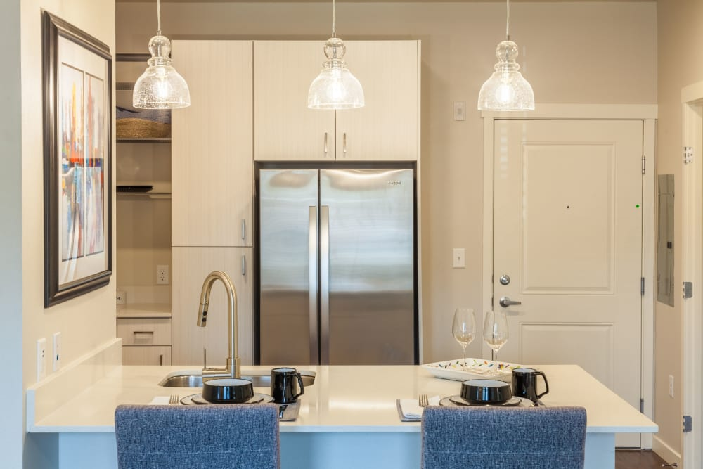 Model kitchen with stainless steel appliances at Capitol Flats in Santa Fe, New Mexico