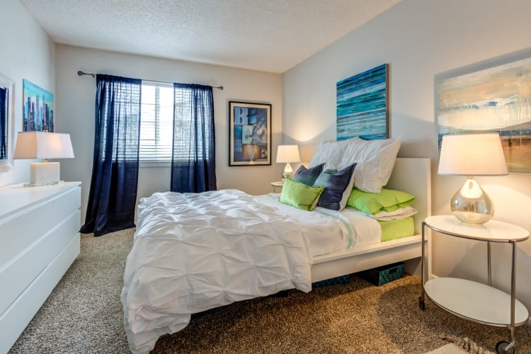 Spacious master bedroom with modern furnishings in a model townhome at Stratus Townhomes in Westminster, Colorado