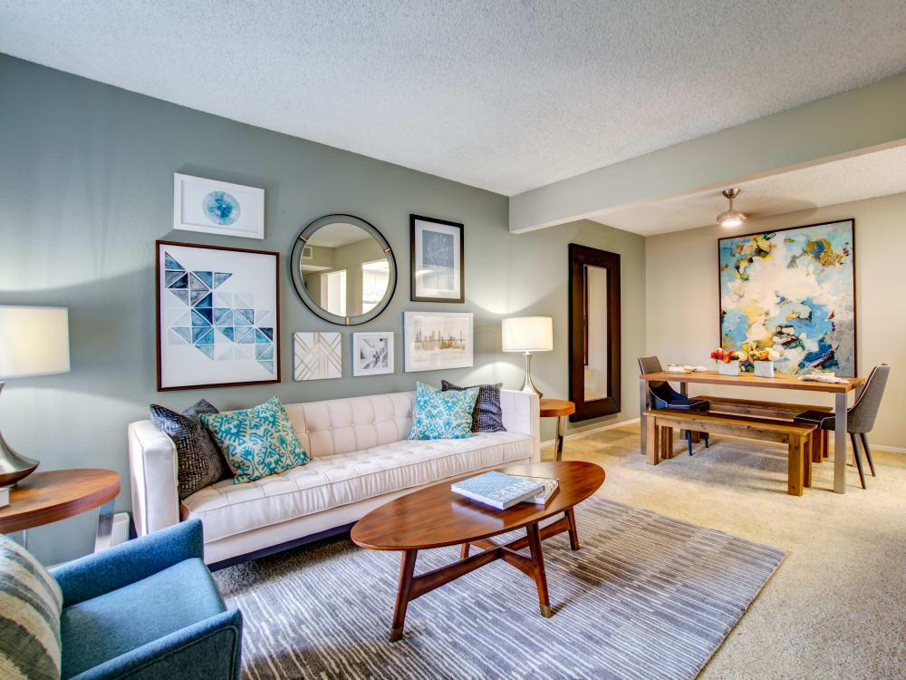 Well-furnished open-concept living and dining areas in a model home at Vue Fremont in Fremont, California