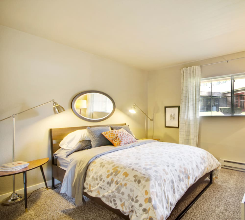 Master bedroom with plush carpeting at The Carriages at Fairwood Downs in Renton, Washington