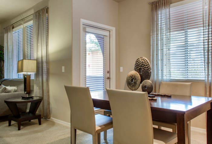 Dining area with adjacent door to private patio of model home at The Residences at Stadium Village in Surprise, Arizona