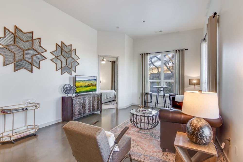 Model living room area at 12 South Apartments in Nashville, Tennessee