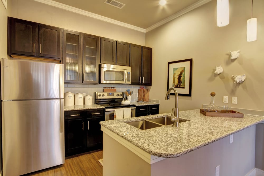 Bright and open kitchen with stainless steel appliances at Marquis at Barton Trails in Austin, Texas