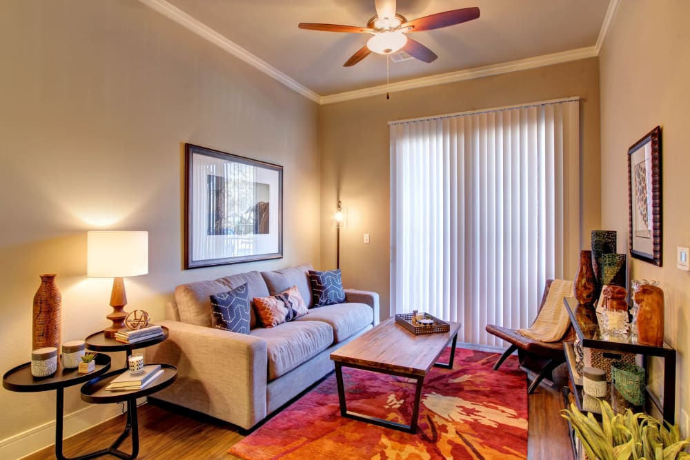 Open floor plan living room with wood flooring and ceiling fan at Marquis at Barton Trails in Austin, Texas