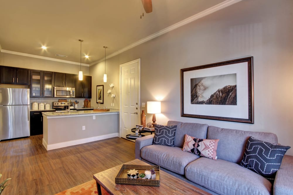 Open floor living area with wood flooring at Marquis at Barton Trails in Austin, Texas
