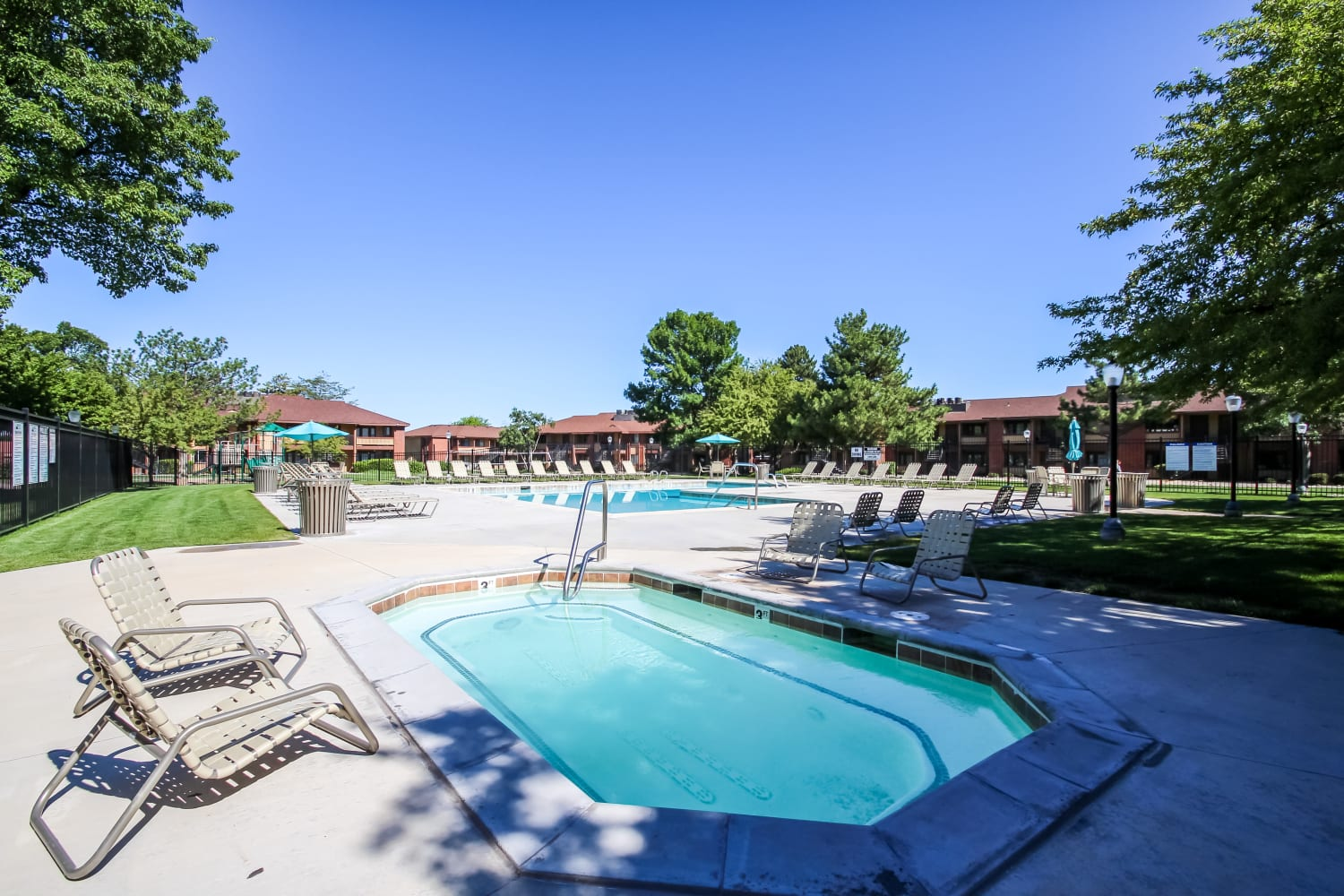 Enjoy having access to a large swimming pool at Wasatch Club Apartments in Midvale, Utah