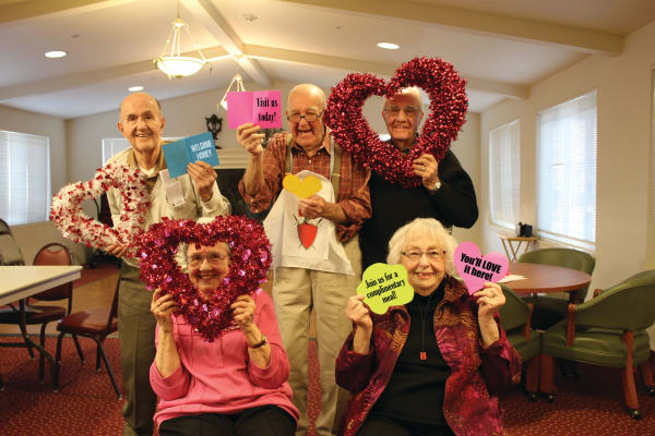 Seniors posing for a picture at Springwood Landing Gracious Retirement Living in Vancouver, Washington