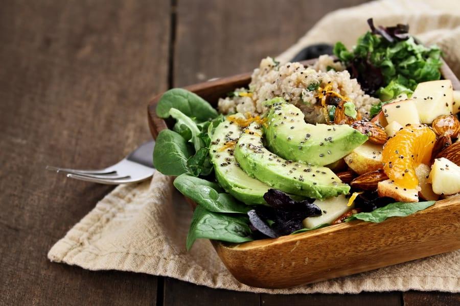Healthy salad with quinoa and avocado prepared at a restaurant near Mia in Palo Alto, California