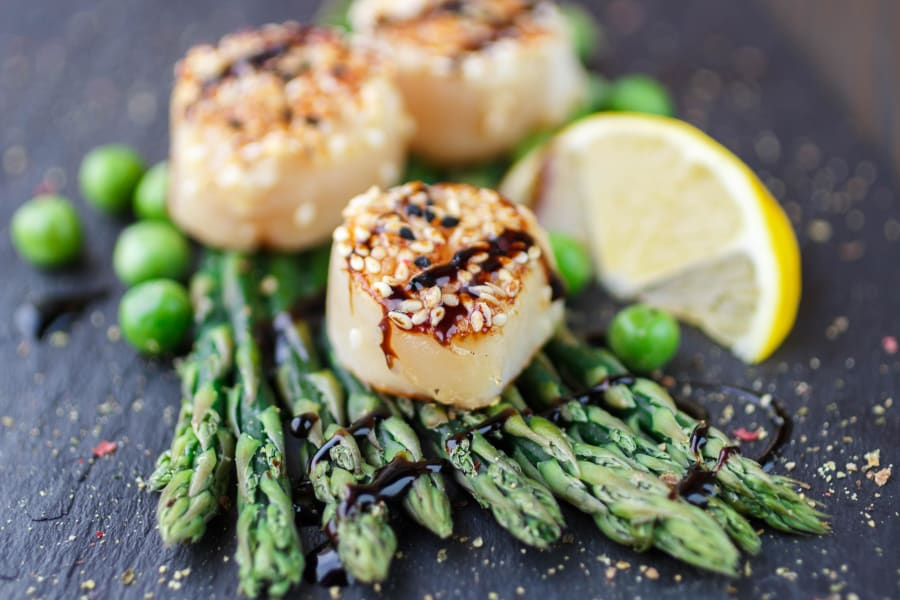 Beautifully presented scallops and asparagus dish at a restaurant near The Landmark Apartment Homes in Sunnyvale, California