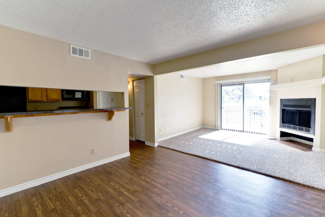 Bright and open floor plan with hardwood floors at The Belmont in Grand Prairie, Texas