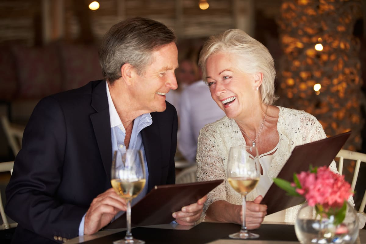Lovely senior couple dining out near The Village of Southampton in Houston, Texas