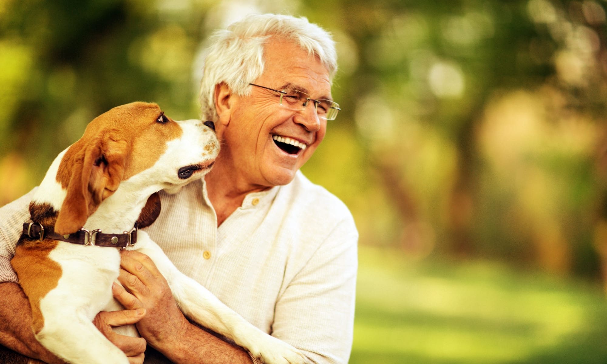 Man with a dog at Retirement Center Management in Houston, Texas