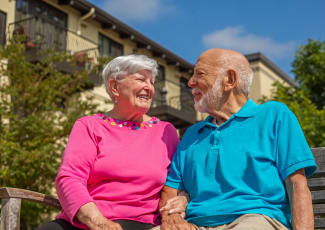 Resident couple laughing with each other at Merrill Gardens at Green Valley Ranch