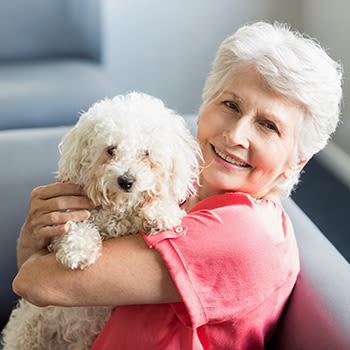Woman with a dog at Wyndham Court of Plano in Plano, Texas