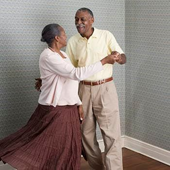 Resident couple dancing at Aspired Living of Prospect Heights in Prospect Heights, Illinois.