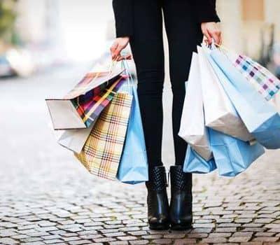 Resident holding shopping bags near Christopher Wren in Wexford, Pennsylvania