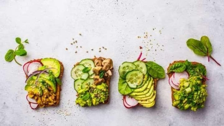 Avacado toast with red onions, mushrooms, and kale