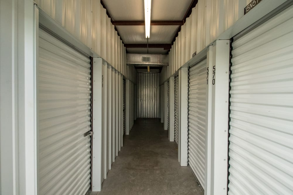 Hall of self storage units at Neighborhood Storage