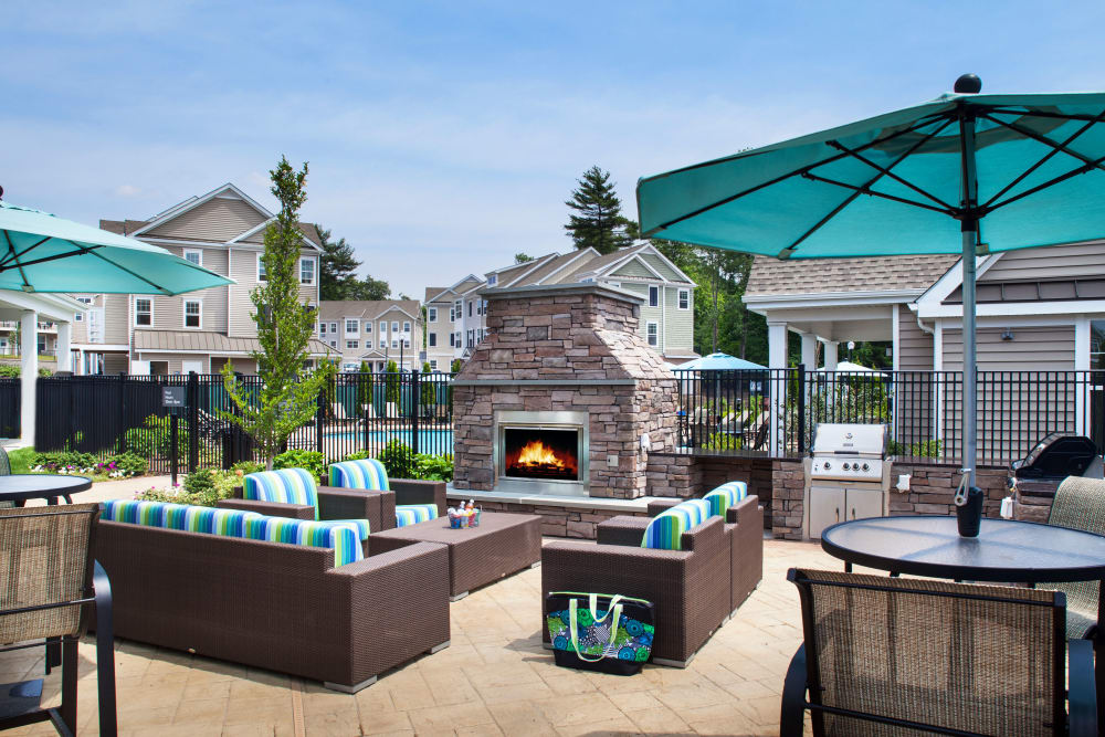 Outdoor fireplace and seating area at Prynne Hills in Canton, Massachusetts