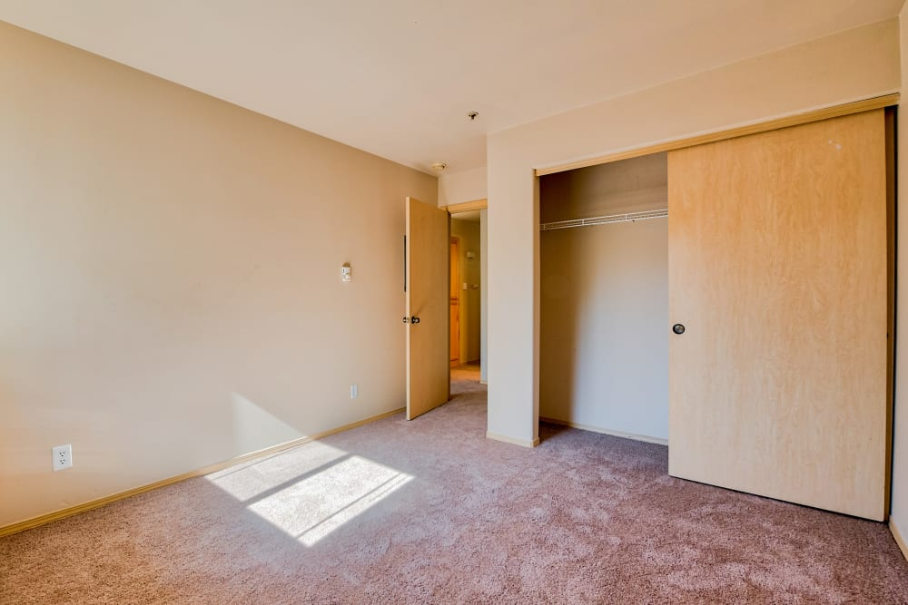 Bedroom with oversized closet at Aravia Apartments in Tacoma, Washington