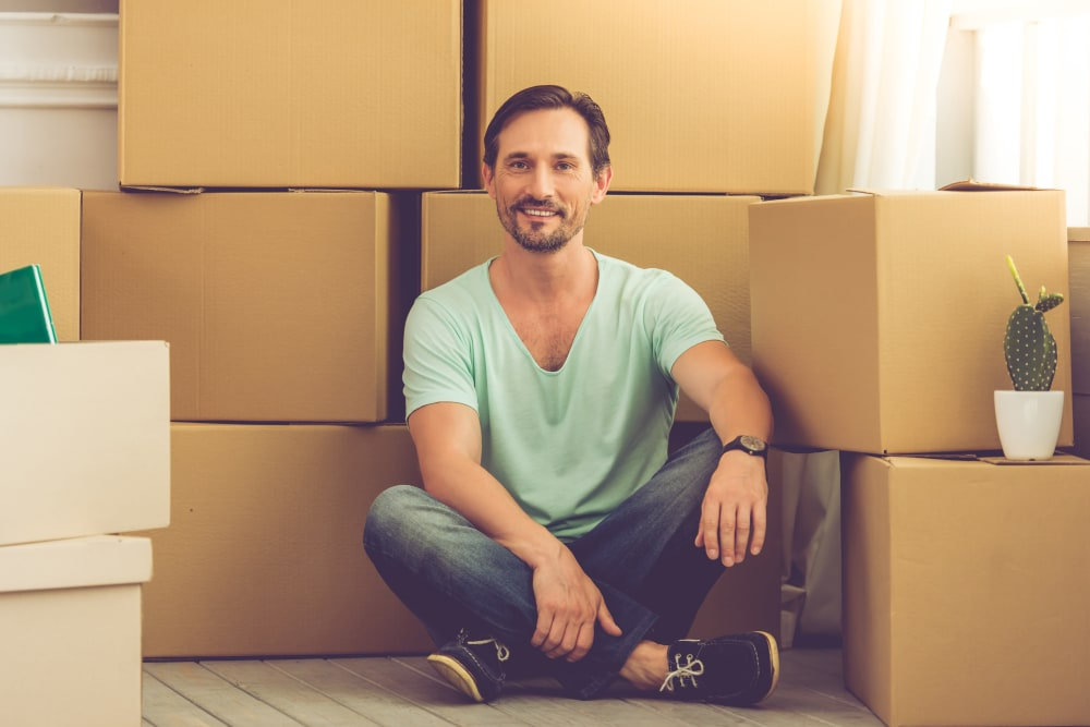 A man surrounded by boxes in Augusta, Georgia near Wheeler Road Self Storage