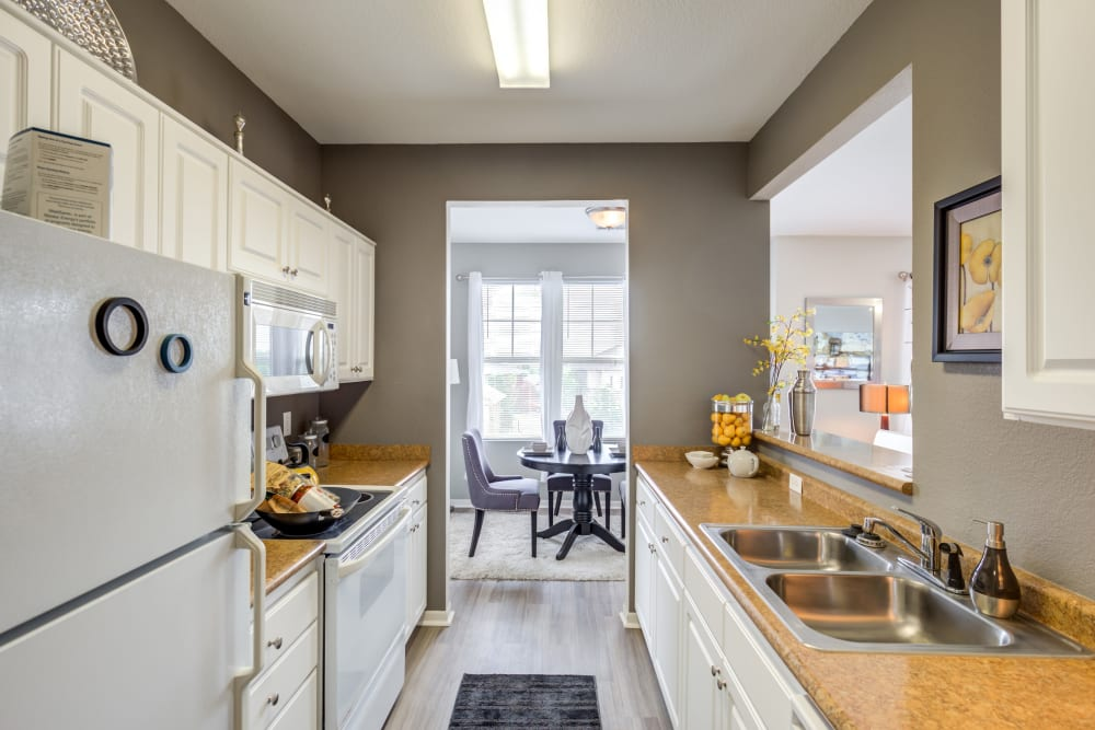 Open kitchen with a pass-through window at Alvadora Apartments in Lawrence, Kansas