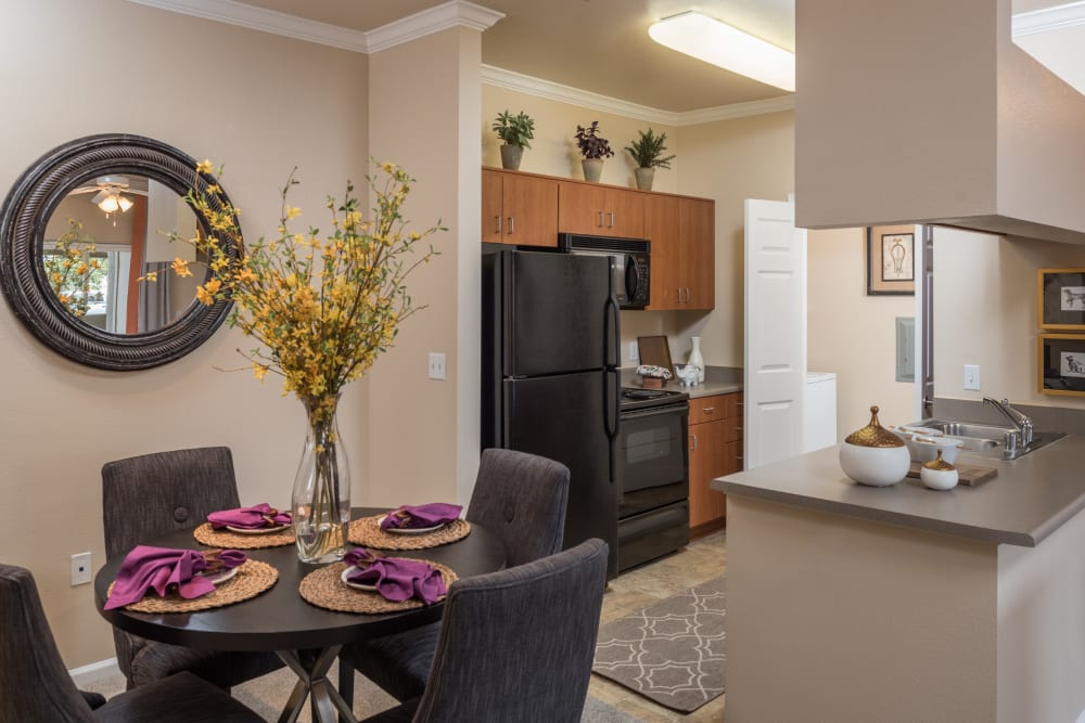 A standard kitchen and dining room at Esplanade Apartment Homes in Riverside, California