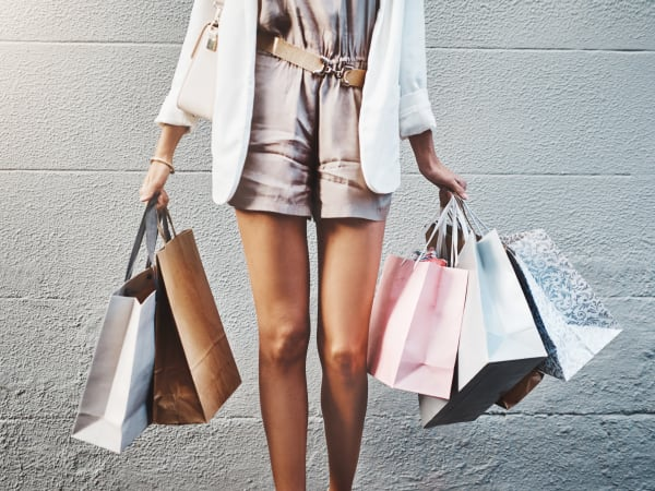 Woman with shopping bags near TerraLane at South Mountain in Phoenix, Arizona