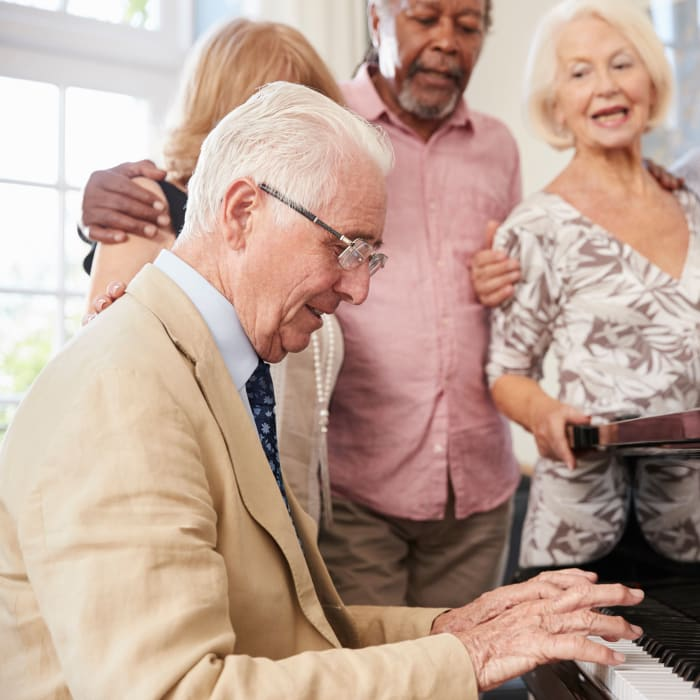 Group singalong around a piano at The Preserve of Roseville in Roseville, Minnesota